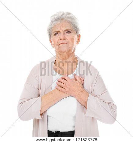 Elderly woman having heart attack on white background