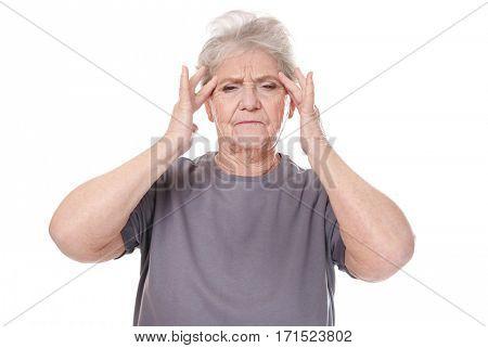 Elderly woman suffering from headache on white background