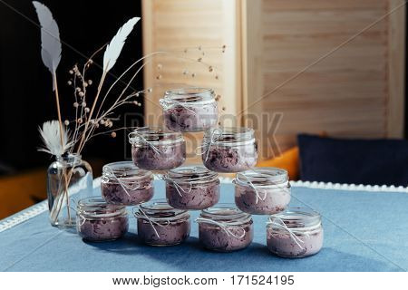 Blueberry dessert and fresh berries in a glass jar