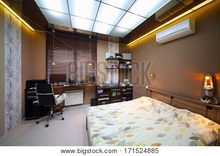 Empty modern bedroom with double bed with workplace and luminous ceiling