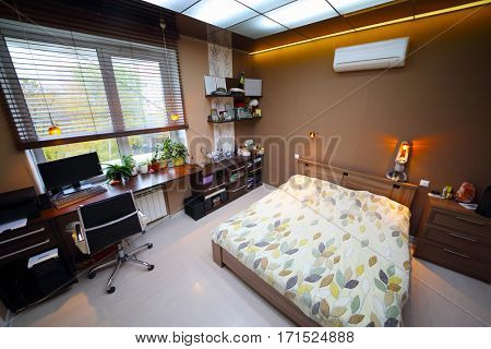 Cozy empty modern bedroom with bed with workplace and luminous ceiling, top view