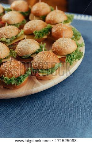 Hamburger on wood table. Home made burger. Fastfood meal. Pub burger. Delicious Hamburger. Gourmet hamburger.