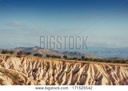 Beauty geological formations in Cappadocia, Turkey. Cappadocia with its valley, ravine, hills, located between the volcanic mountains in Goreme National Park.