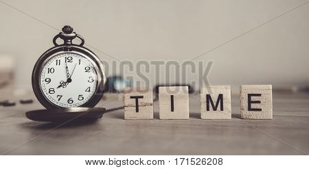 the concept of time.TIME written on wood cube