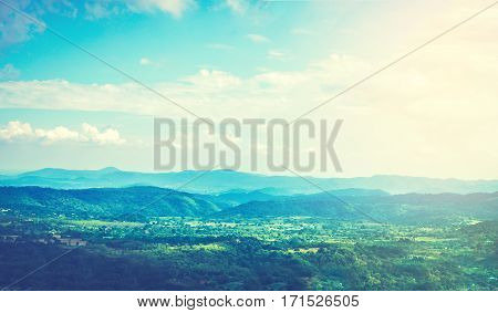 Amazing picture of green mountain landscape with blue sky and white clouds. Great nature scenery of green mountain range under sunlight at the middle of summer day