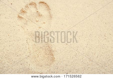 foot print stamp on sand beach in morring sun shine