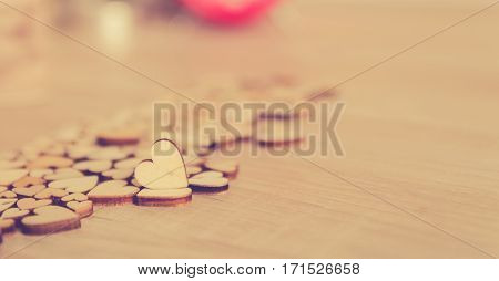 woodden heart shape on wood table valentine or lovebackground