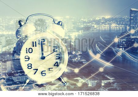 Businesses concept photo of double exposure style modern alarm clock with building and river at metropolis in night time and business graph or chart Time or duration concept in progress