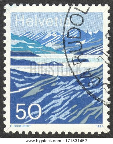 MOSCOW RUSSIA - CIRCA JANUARY 2017: a post stamp printed in SWITZERLAND shows Mountain Lakes circa 1991