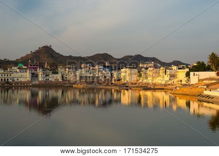 Cityscape At Pushkar, Rajasthan, India. Temples, Buildings And Ghats Reflecting On The Holy Water Of