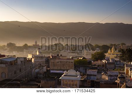 Cityscape From Above At Pushkar, Rajasthan, India. Temples, Buildings And Ghats Under Winter Morning