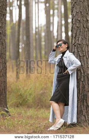 asian woman relaxing emotion toothy smiling in pine forest