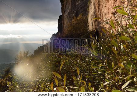 Spring morning mountain landscape. Rock in the sunlight background. Dramatic sky. Catalonia, Spain, Europe.