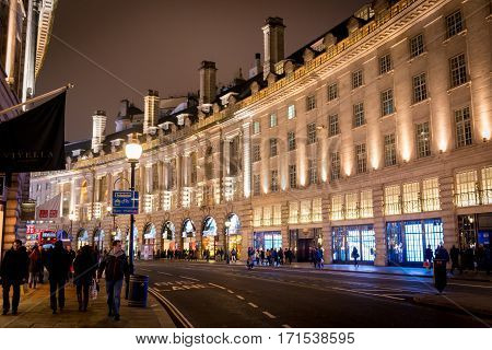 Night view of Regent Street in London on Jan 2014. Regent Street is London's busiest shopping neighborhood that attracts tourists all over the world.