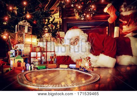 Santa Claus playing with toys under the Christmas tree.