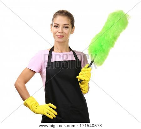Beautiful charwoman with duster on white background