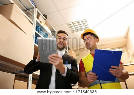Two businessmen at warehouse