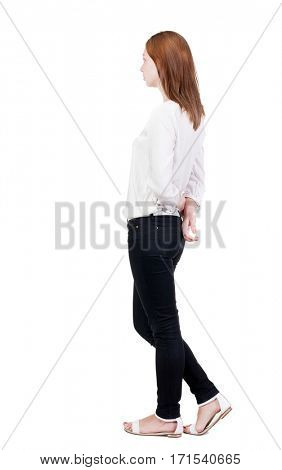 back view of standing young beautiful  blonde woman in jeans. girl  watching. Rear view people collection.  backside view of person.  Isolated over white background.