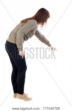 Back view of  pointing woman. beautiful girl. Rear view people collection.  backside view of person.  Isolated over white background
