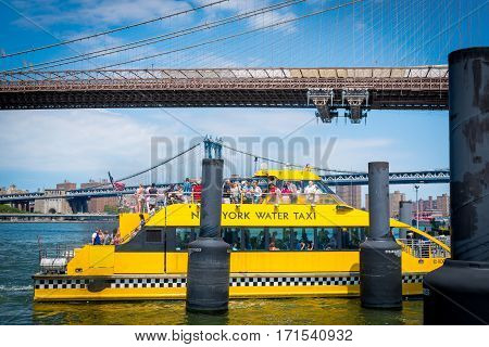 Passengers arrived the Brooklyn Bridge port and getting off the NYC Water Taxi on Aug 11th, 2013.