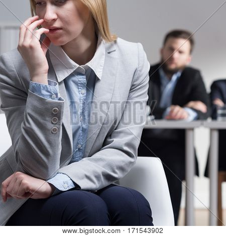 Young pretty woman worried about her job interview with corporate lawyers