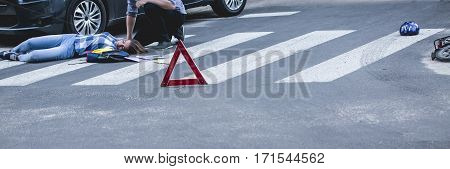Car Driver Helping Unconscious Victim