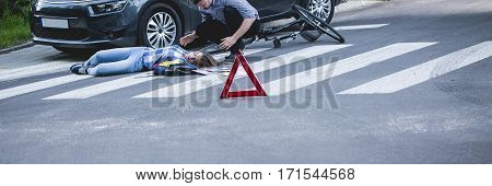 Unconscious Car Accident Victim Lying On A Street