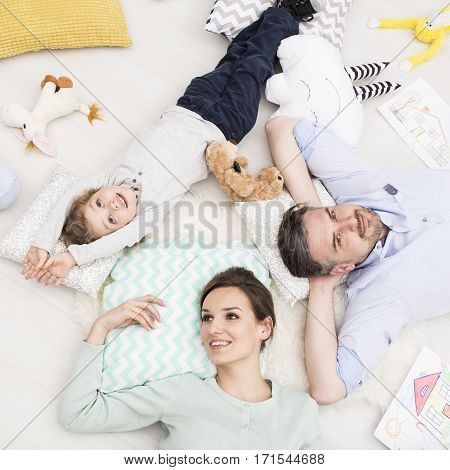 Cheerful Mom, Dad And Son