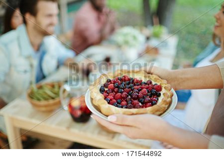 Fresh open pie with berry mixture for festive dinner