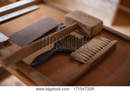 some old and vintage carpenter's tools in his worshop