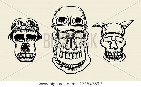 Hand drawn skulls. Blackicons on beuge background. Vector Illustrations set