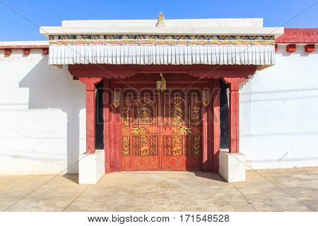The front facade & doorway of a temple in Ganzi Sichuan China Tibet