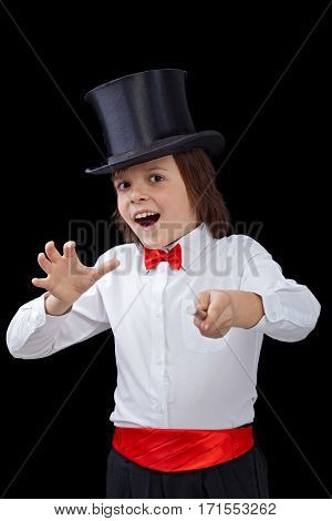 Young magician in the heat of a trick - performing on black background
