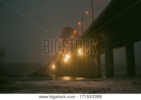River Dredge Produces Sand From The Bottom Of The Bridge, After Dark