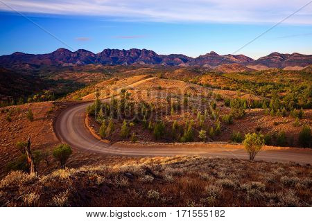 A winding road runs through Bunyeroo Valley in the Flinders Ranges National Park, South Australia, Australia - Outback Australian road.