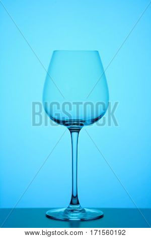 wineglass on blue background, close-up studio shoot