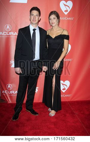 LOS ANGELES - FEB 10:  Christian Riley, Emily Iskra at the Musicares Person of the Year honoring Tom Petty at Los Angeles Convention Center on February 10, 2017 in Los Angeles, CA