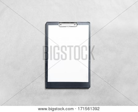 Blank black clipboard with white pages mockup, isolated in textured background. Empty document holder mock up lying on grey desk. Clear clip board organizer template. Office stationery notebook design