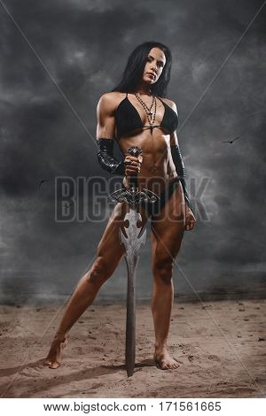 Fantasy Warrior Woman With Big Sword In Mystic Landscape