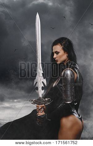 Sexy Fantasy Warrior Woman With Big Sword With Smoke