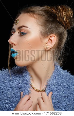 Woman with hairstyle and makeup of 90s. Hipster fashion stylish girl. Turquoise lips. Beauty retouch