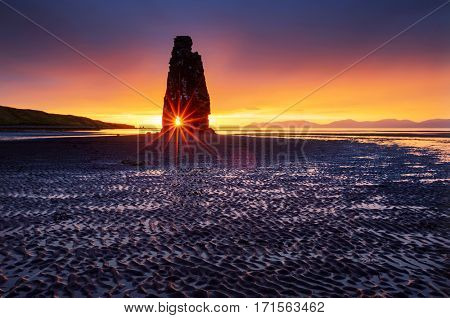 Magic dark sand after the tide. Dramatic and gorgeous scene. Location place Hvitserkur, Vatnsnes peninsula, northwest island Iceland, Europe. Popular tourist attraction. Discover the world of beauty.