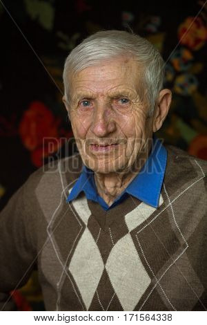 portrait of senior man at his home