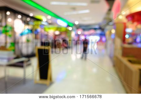 Defocused Clothing Store Front Entrance Displaying Woman's Fashion Shop Store In Department Store.
