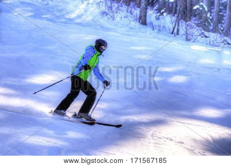 Young man practicing ski sport outdoor on the ski slope. Poiana Brasov resort, Romania