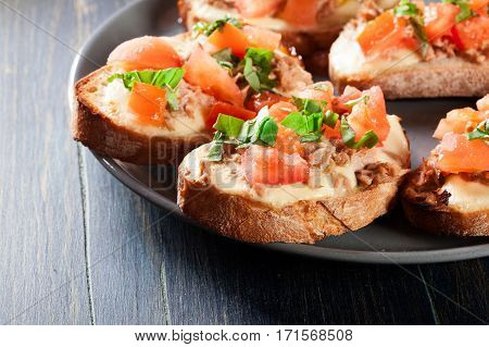 Appetizer Bruschetta With Tuna, Mozarella Cheese And Tomatoes