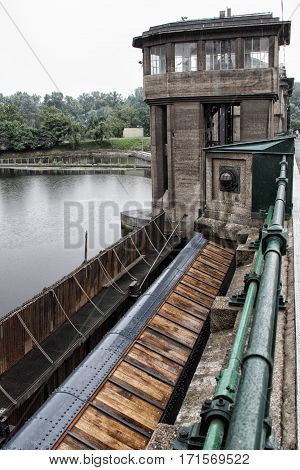 Wooden and metal part of moving weir of the hydraulic power plant