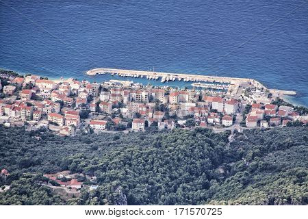 Houses and building of the Tucepi city by the sea from above