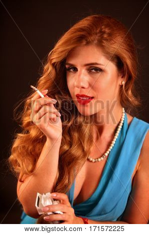 Woman smokes marijuana. Girl smoking cigarette. Smoke is bad habit. Female does not understand that nicotinic acid is harmful to health and female beauty.