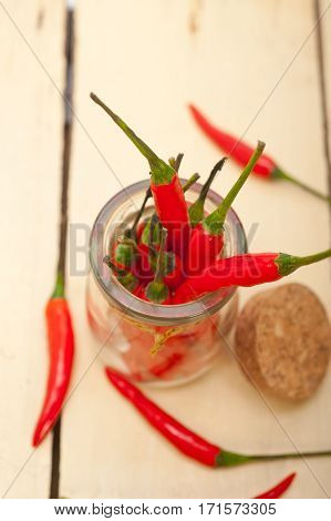 Red Chili Peppers On A Glass Jar